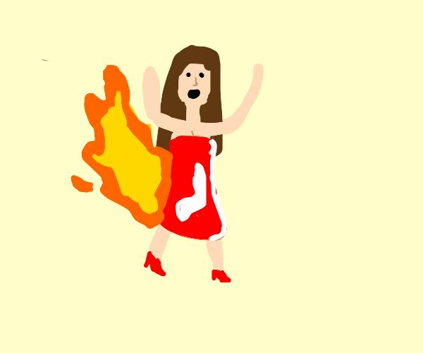A woman in a meat dress on fire