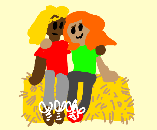 two girls on a hay bale