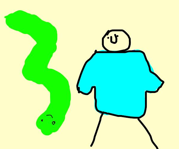 Green happy snake follows man in blue shirt