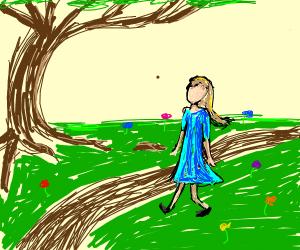 Girl walking in a garden