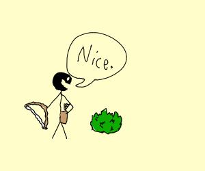 Bow weilding man admires shrub