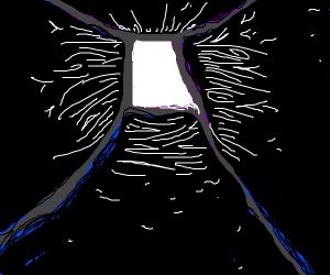 Dark hallway leading to lit doorway