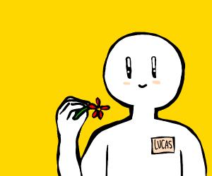 Lucas holding a flower