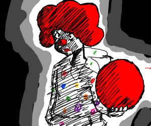Clown holding a huge ball