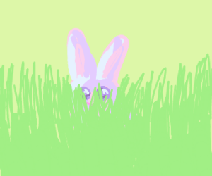 A bunny hiding in grass with long ears