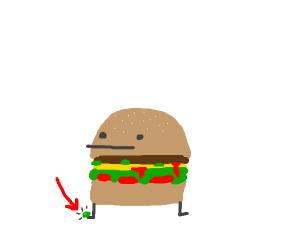 Pickle drop on hamburger guy's feet