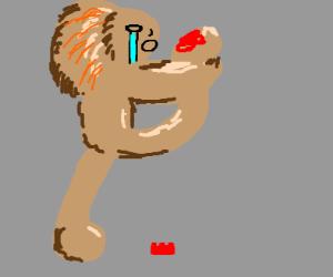 lion stepped on a lego