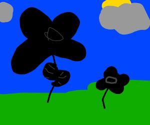 Black scribbles shaped like flowers