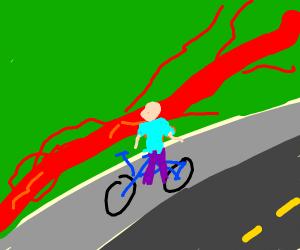 boy on bike on sidewalk next to bloodstream
