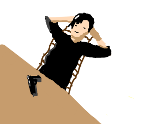 A relaxed guy with a gun on the table