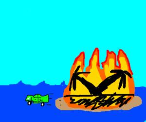 Car driving away as island burns