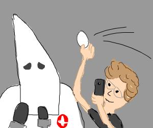 KKK member being egged