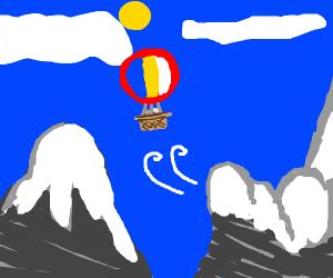 Hot air balloon over the mountains