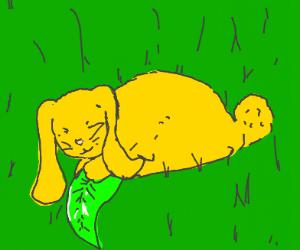 Yellow bunny hugging a leaf