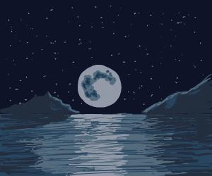 Moon descending into sea
