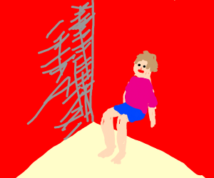 man sits on the wall of a red room