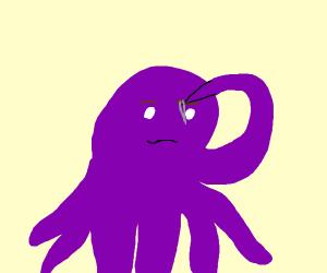 Octopus uses tweezers