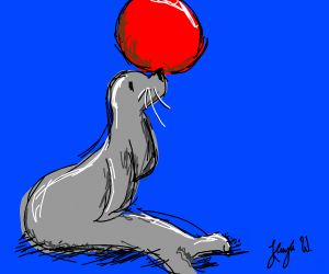 seal playing with red ball