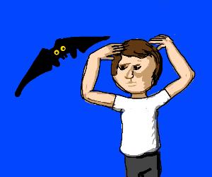 A bat flies at someone's face