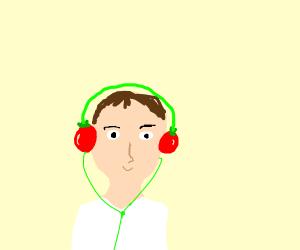 Guy enjoying tomato headphones