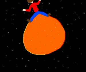 man riding an orange in space