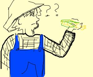 Farmer looks questionably at corn