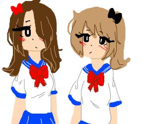 Japanese teens in uniforn staring