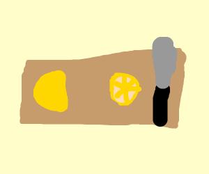 a lemon cut in half by a knife