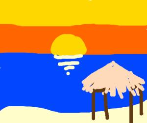 tiki hut at sunset on beach