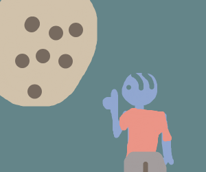 Man admiring giant cookie