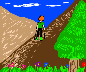 Guy hiking up a mountainside