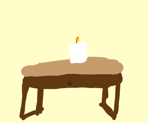 white candle on a tiny table
