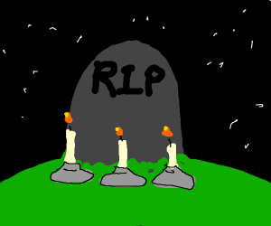 candles in front of gravestone