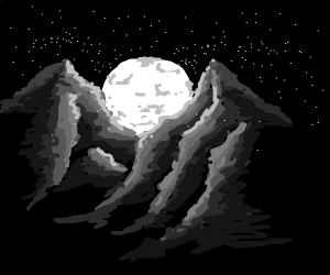 Moon rising behind two mountains