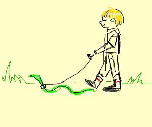 Small boy taking snake on a walk