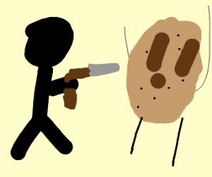man points gun at cookie person
