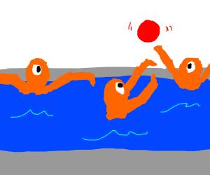 three orange cyclopses in a pool