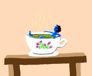 blue guy enjoying a bath in a cup of tea