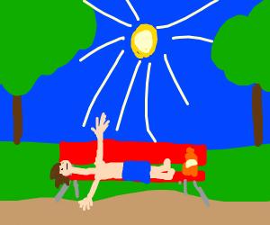 long neck man sunbathes at the park