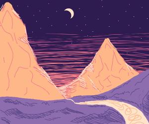 dawn rising between mountains