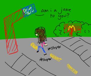 girl walks through McDonald's Drive-thru