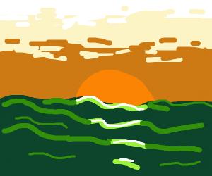 sun set over green ocean