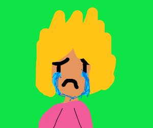 blonde boy cries over green screen