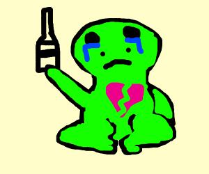 Heartbroken frog drinks to forget