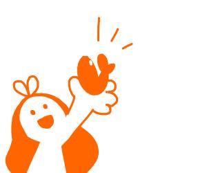 Woman Holds Up Goldfish