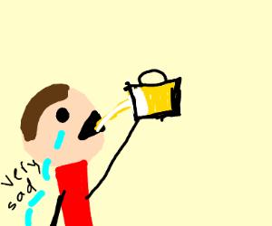 Sad man drinking beer