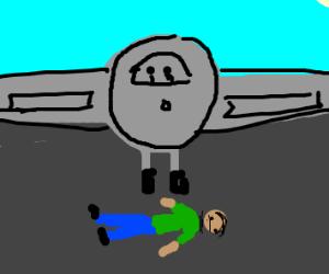 Guy lies down on airplane runway!