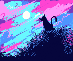 Black cat laying on a hay bale