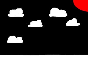 Clouds in a pitch-dark sky.