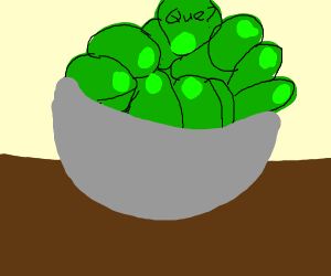 Bowl of green olives. Olive on top is the que